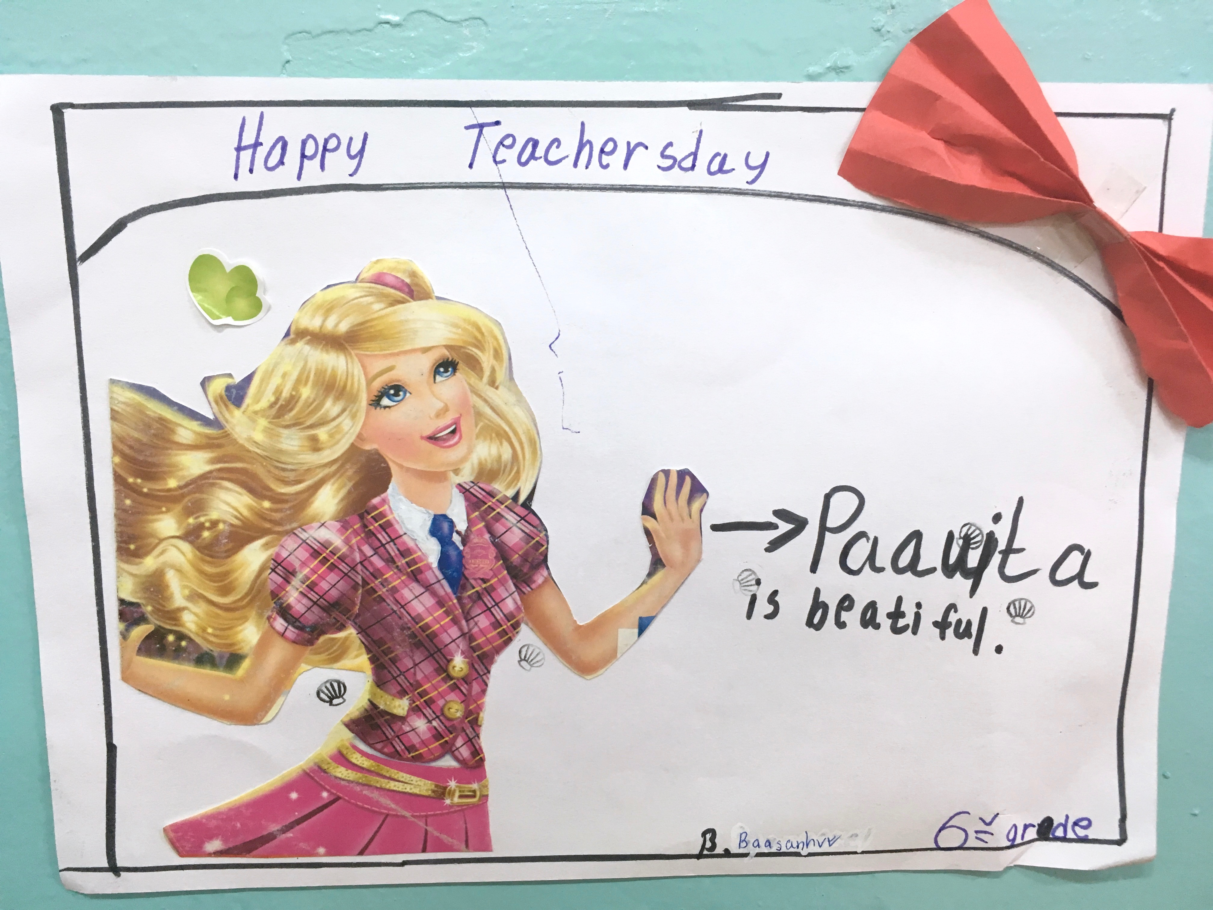 As symbolized in this Teacher's Day card, I mostly stand around looking pretty, and I think the students are really responding to that.